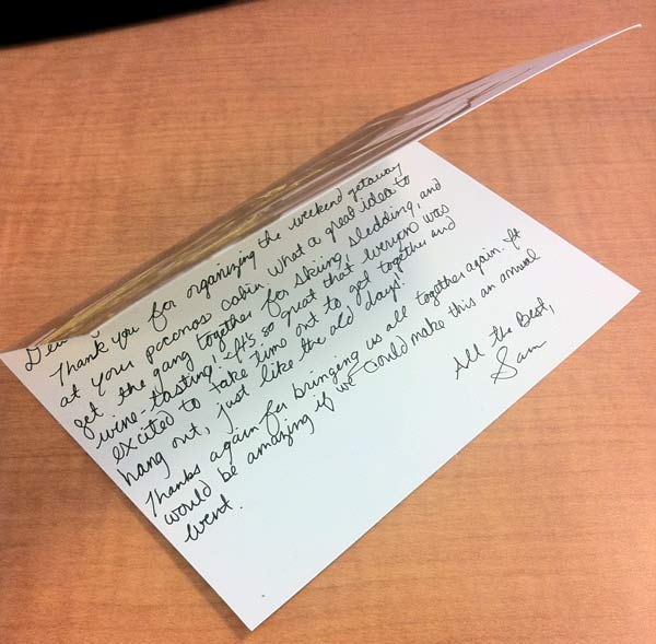 A thank you note received by a vacation rental owner is opened.