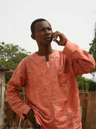 An African man using a cell phone