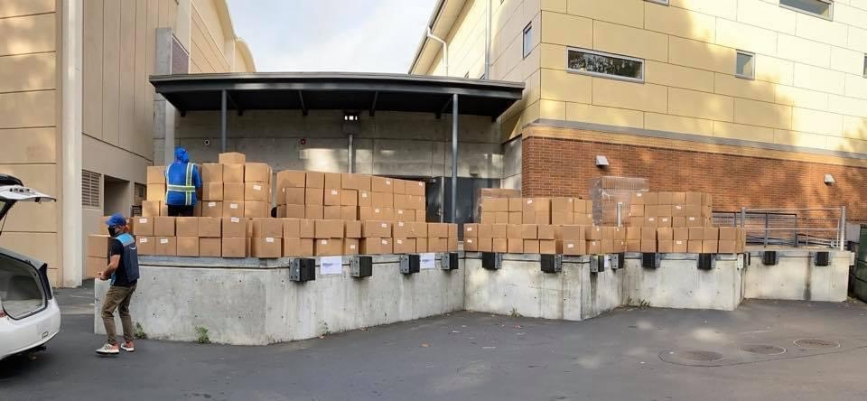 On October 13, 2020, Denny Middle School in West Seattle processed 3,223 boxes of food (a four-day supply) for Amazon delivery to student families