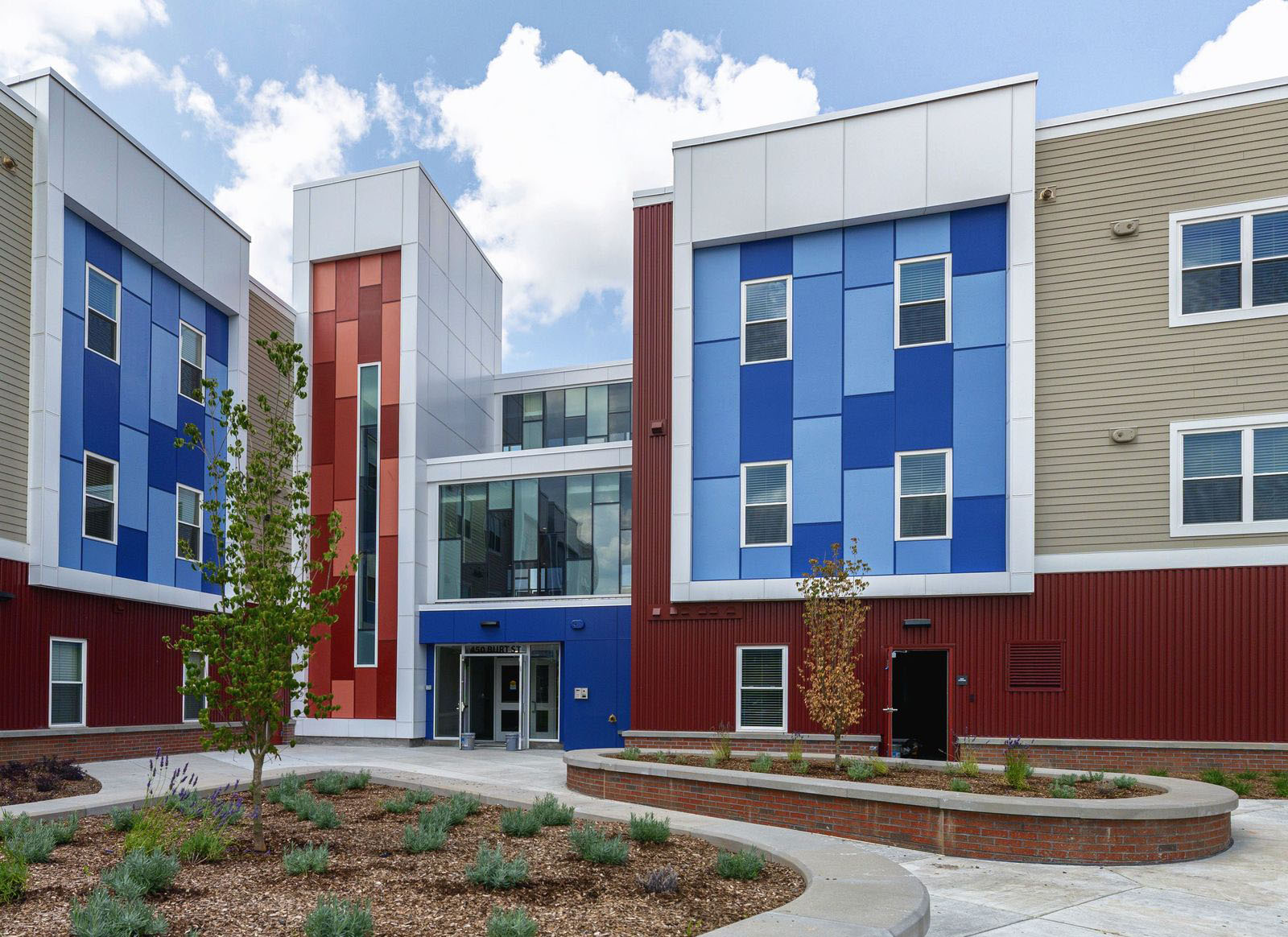 Bright blue and red panels adorn an apartment building