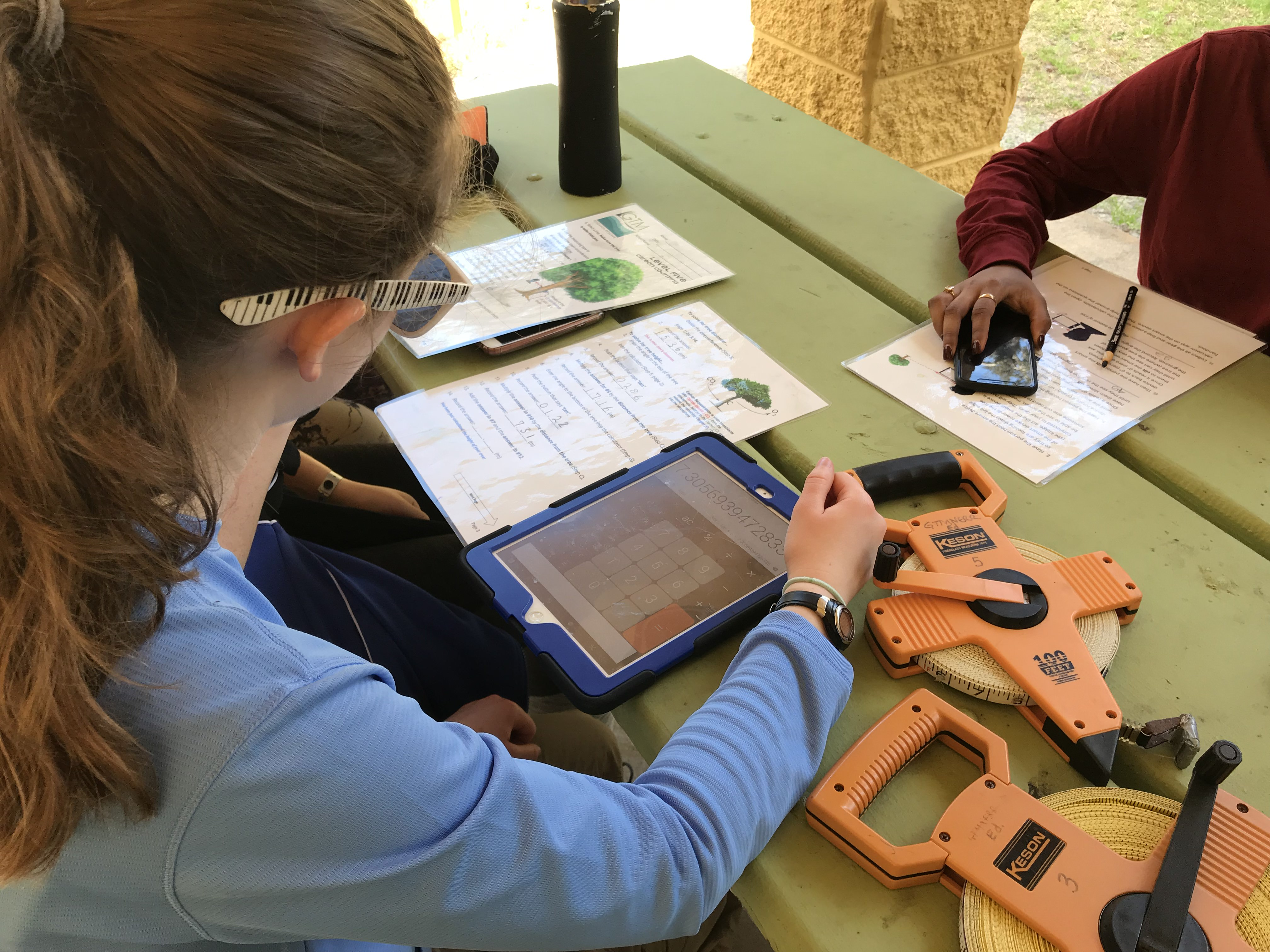 Students work on a project with technical tools
