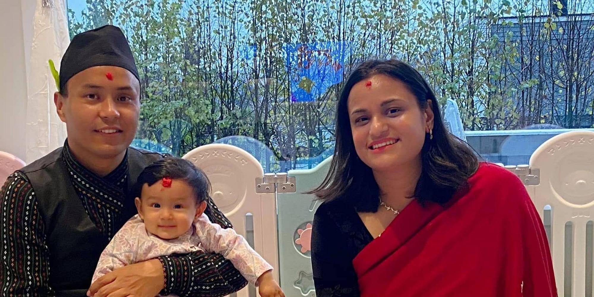 Santosh, Quree, and little Luniva celebrating the Dashain festival in traditional Newari attire.