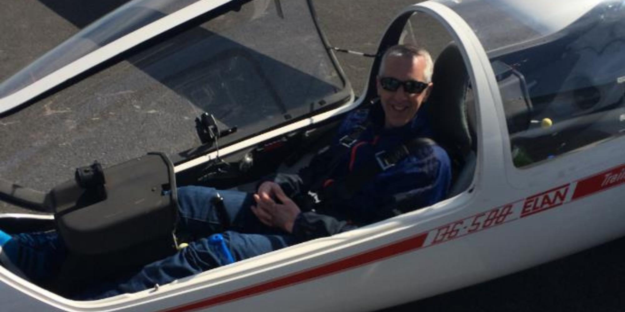 Martin Laitt sitting co-pilot in a D6-500 Air plane.