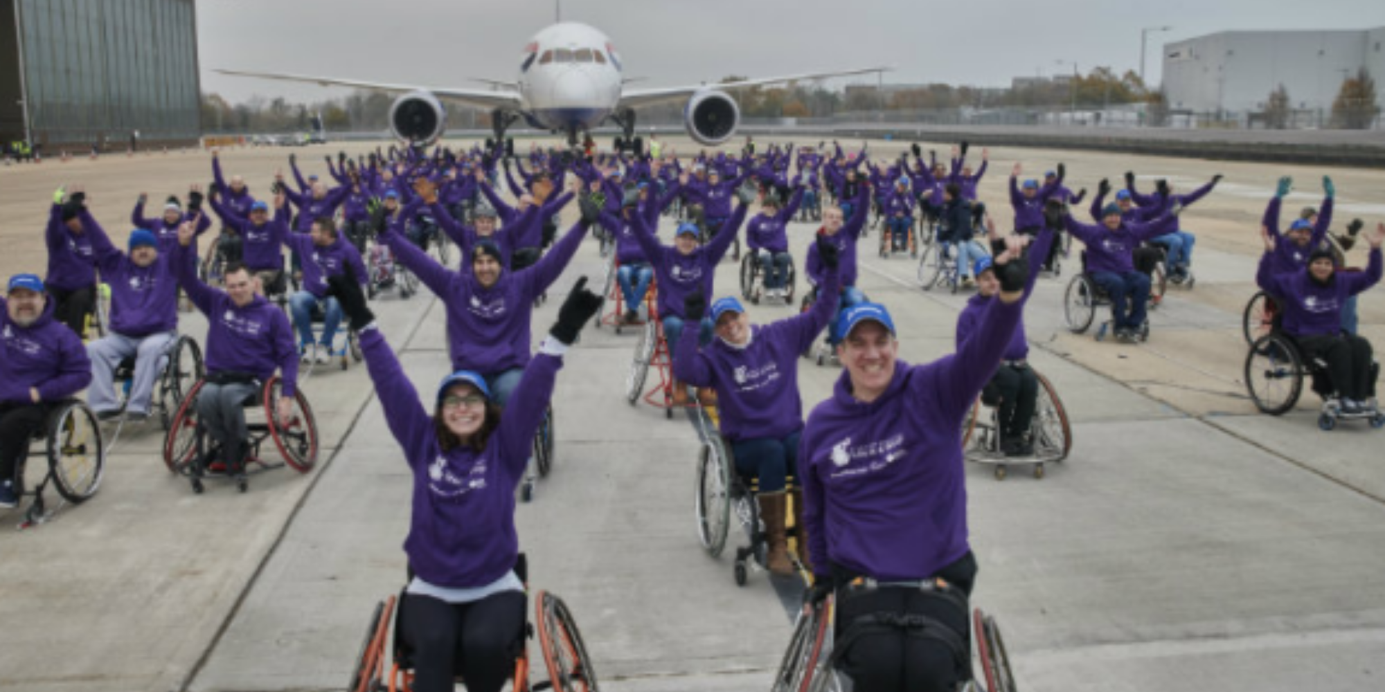 The team on 100 people in wheel chairs who broken the world record for pulling the heaviest plane.