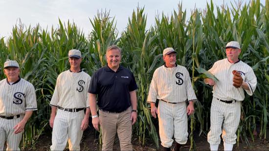 Baseball players in a corn field